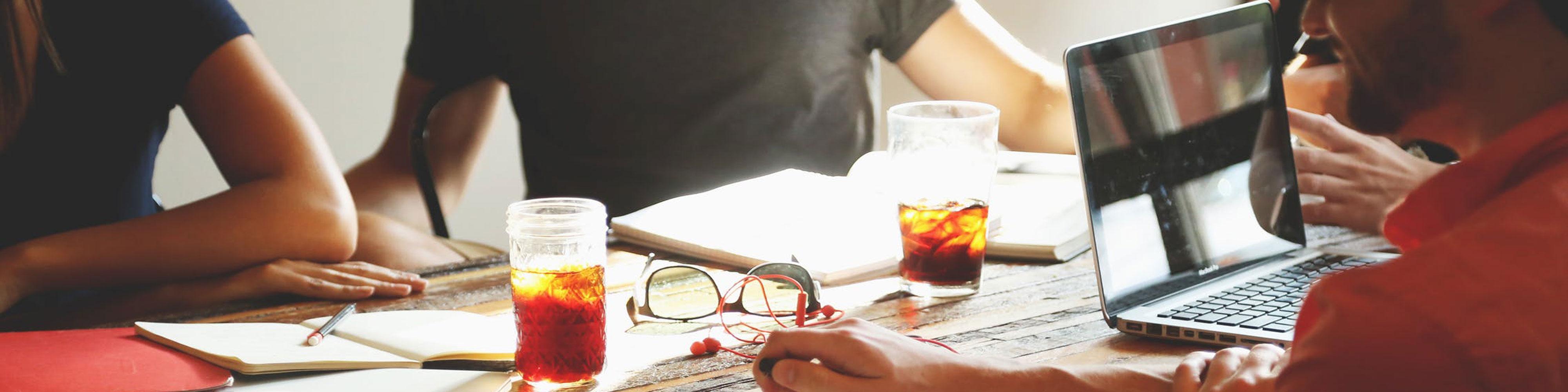 Expert Language Interpreters having meeting with tea and coffee