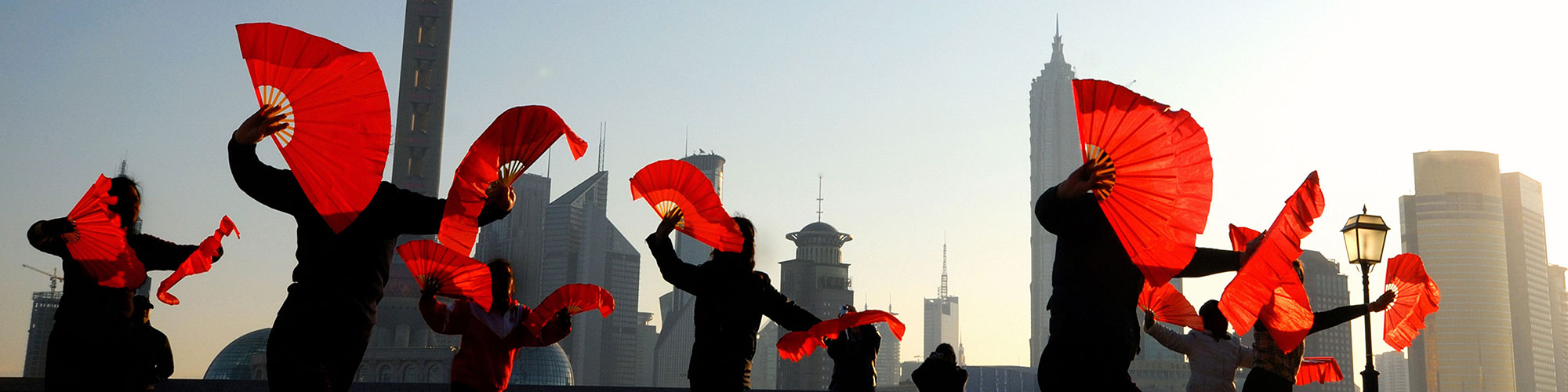 Simplified Chinese Traditional Dance with Red Fans