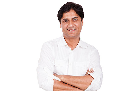 Hindi Translation Services Professional on White Background with Arms Folded