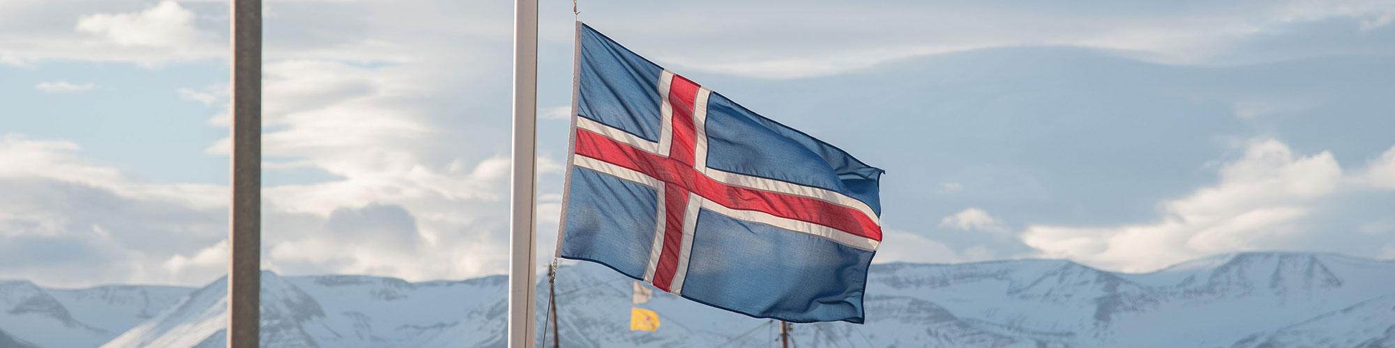 Icelandic Translation Service Flag in Snow Mountains of Iceland