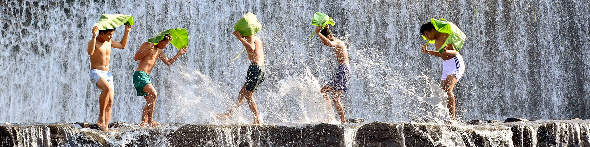 Indonesian Kids Playing Waterfall Large Leaves Head