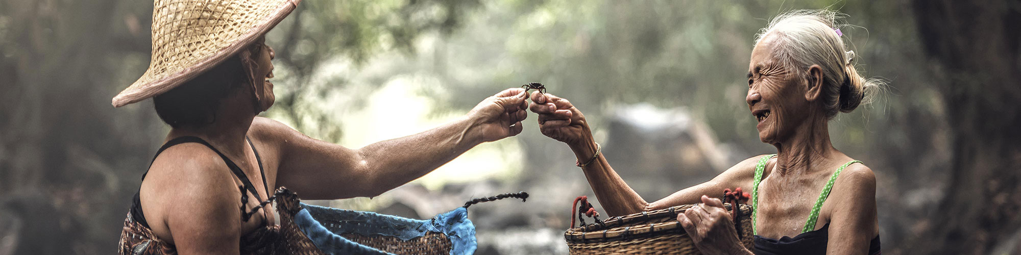 Indonesian Elderly Both Holding Crab