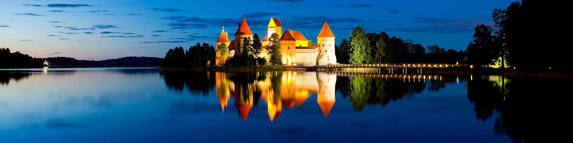 Lithuanian Translations Symbolised by Lake Castle at Night