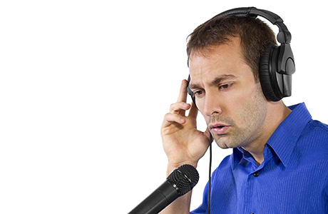 Multilingual Voice Over Artist on the Microphone