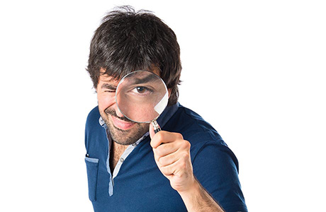 Proofreading Translation Expert Looking Through a Magnifying Glass