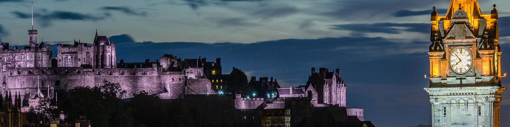 Scottish Castle in Evening with Clock Tower