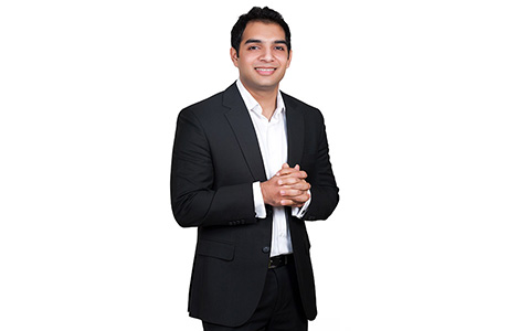 Professional Urdu Translator Crossing Hands in Front of Body