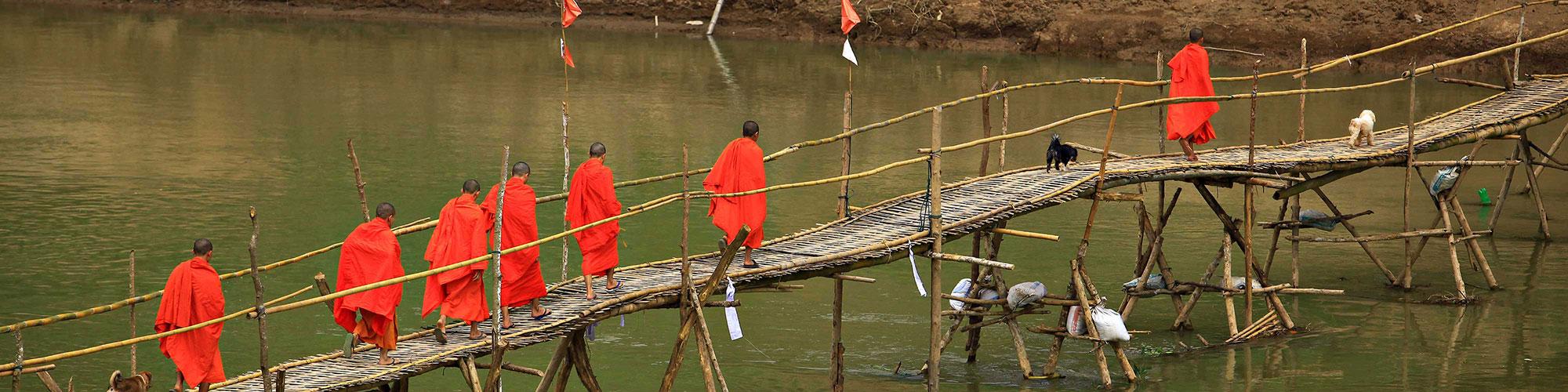 Laotian Speaking Monks on Stick Bridge