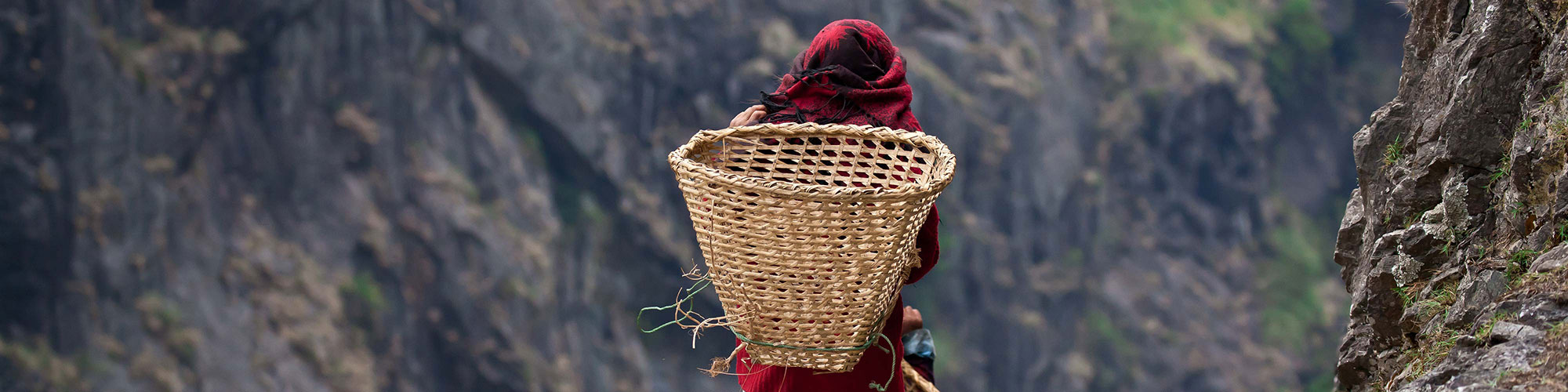 Nepali Translation Company Symbolised by Nepali Male Walking Mountains