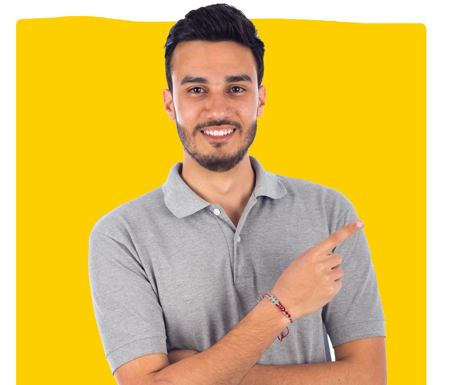 Young Egyptian translation specialist smiling and pointing wearing a grey shirt