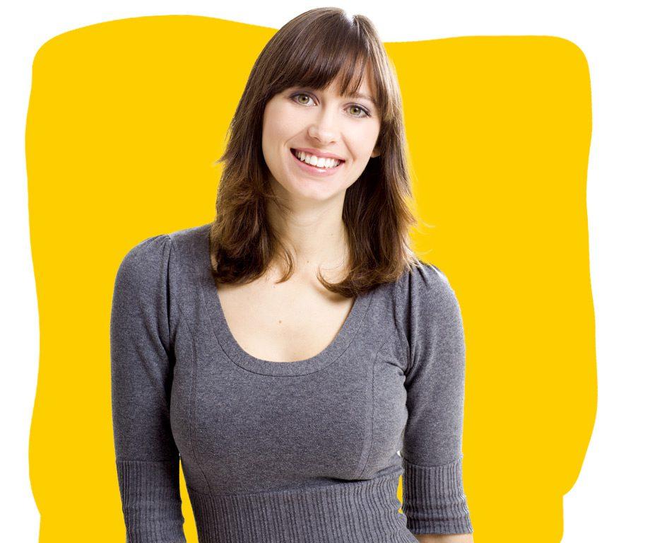 Austrian German Translation Services Professional Smiling Grey Jumper