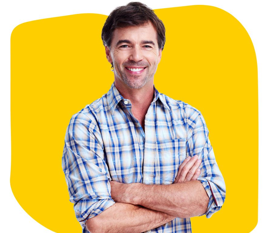 Basque Translation Services Professional smiling with folded arms wearing checked shirt