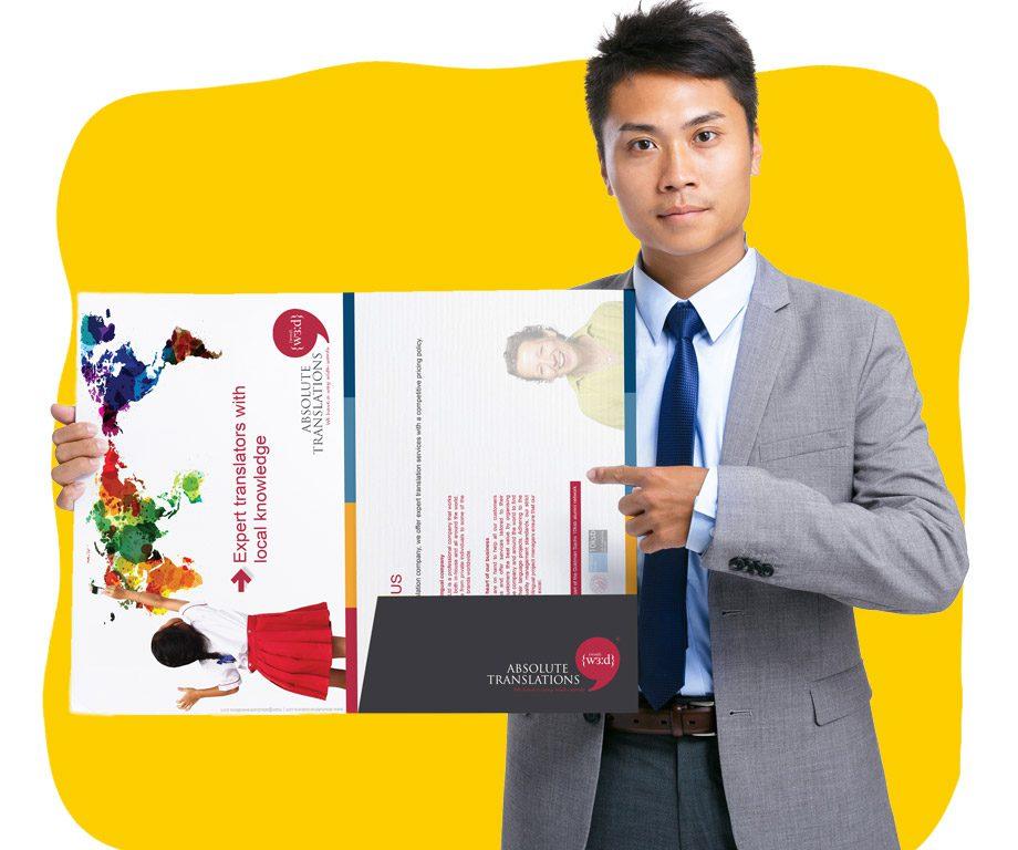 Brochure translator holding translated technical leaflet.