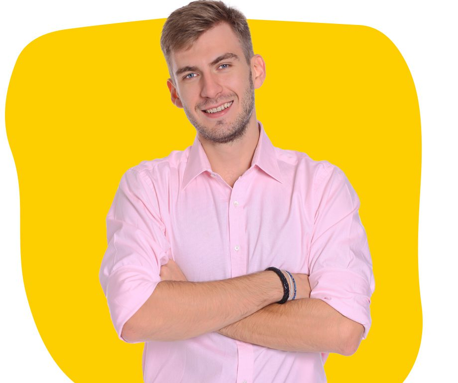 German translation expert in pink shirt smiling with folded arms
